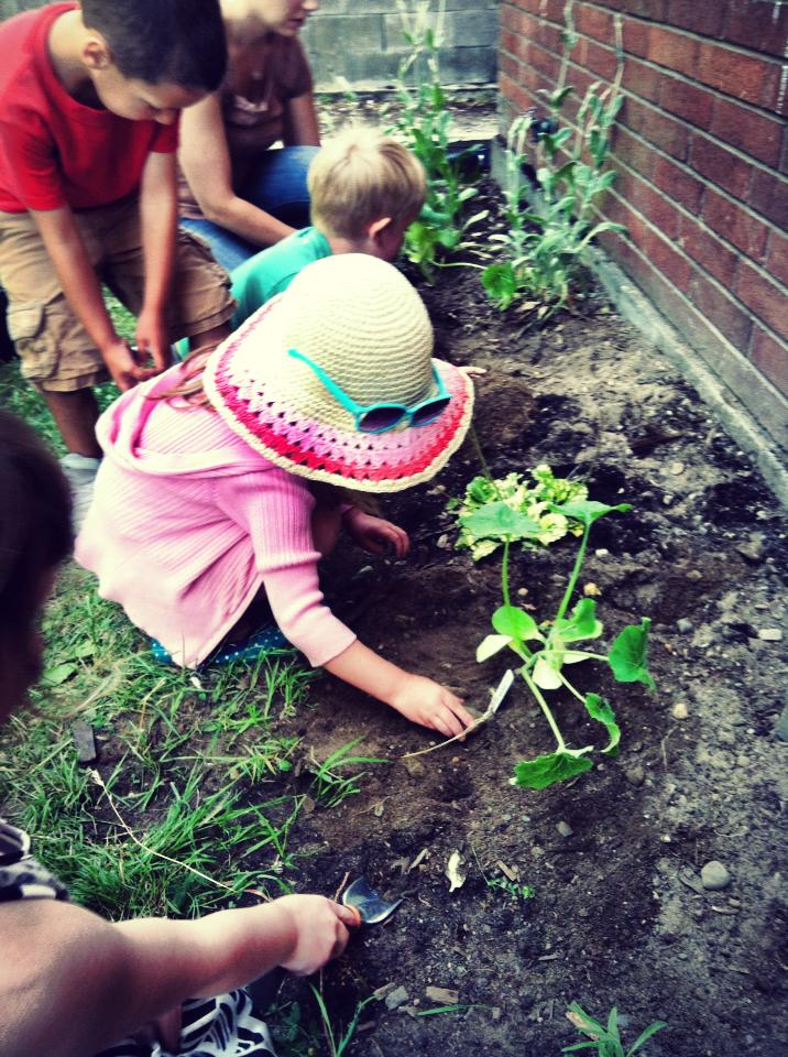 Children planting pumpkins. Photo by Jeanine Carlson